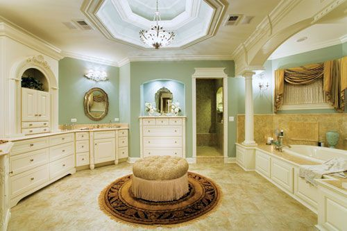 I like the simple tufted round ottoman on a round rug in for Master bathroom ottoman
