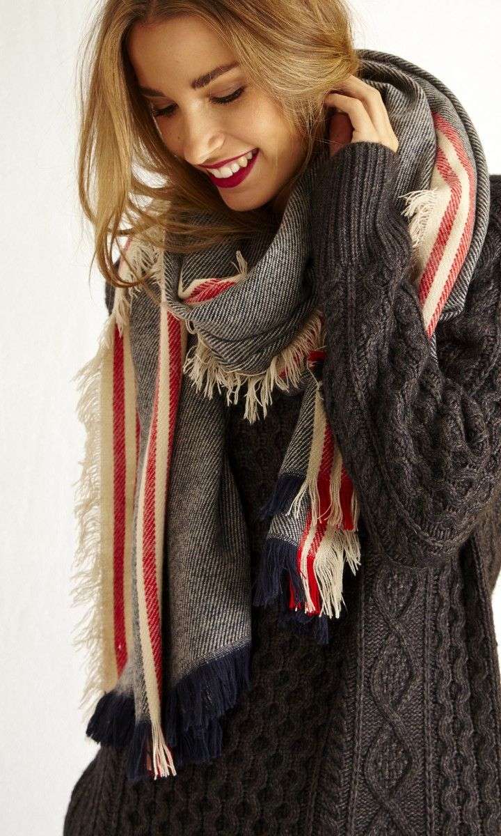 Woven, striped and super cozy: This oversized scarf with raw trim and fringe edges.