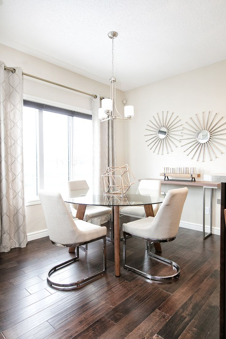 Such beautiful beige and wood tones being used in the dining nook.