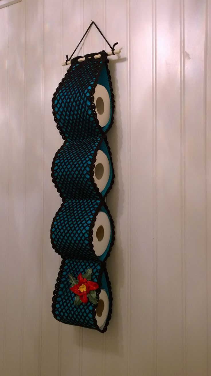 Holder for toilet paper. The black net is crocheted, the blue is from a towel. The flower is also crocheted. Everything is made from my head - no pattern. :-)