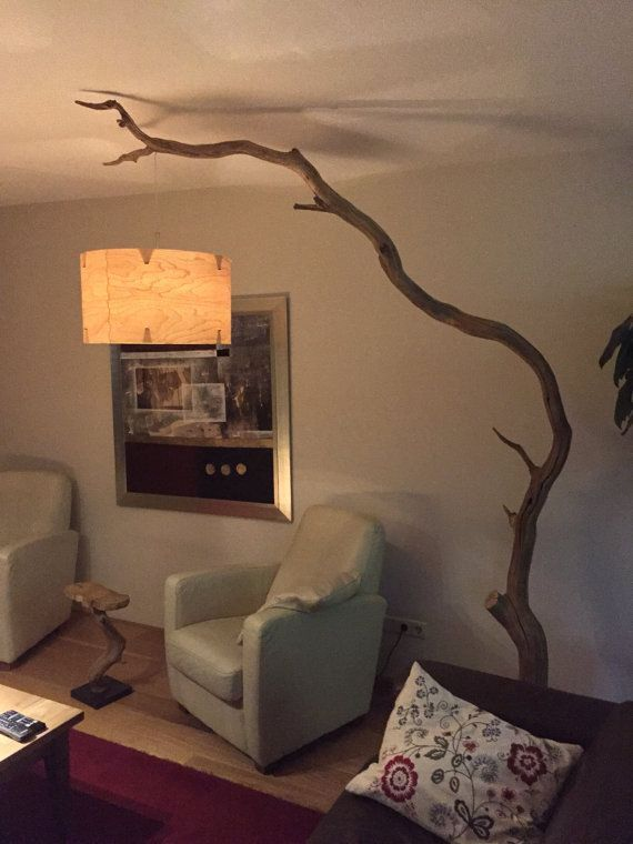 – Floor lamp of old weathered Oak branch on black natural stone plate