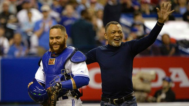 Blue Jays catcher Russell Martin is accompanied by his father Russell Martin Sr. as he leaves the...
