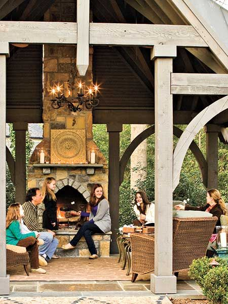 Love this fireplace, love the chandelier, love the outdoor living room!!