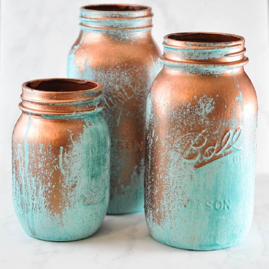 Create this verdigris look on mason jars by using reactive metal paint. It's an easy way to get big effect.