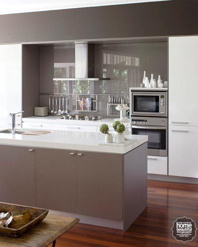 A palette of earthy, modern neutrals defines this contemporary kitchen, with…