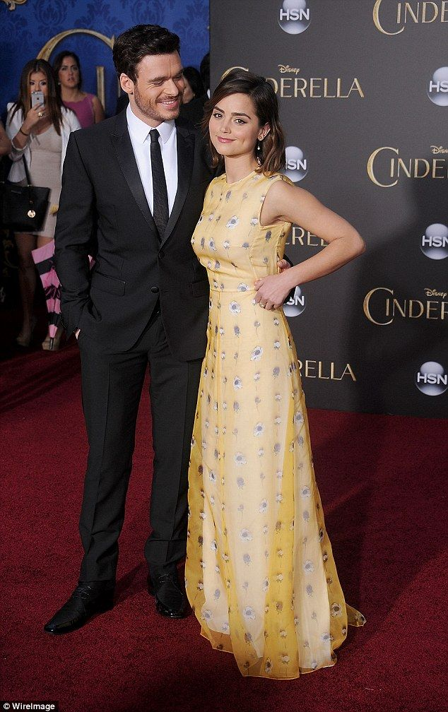 Ray of sunshine: The actor gazed lovingly at his other half, who wore a yellow gown featuring a daisy print