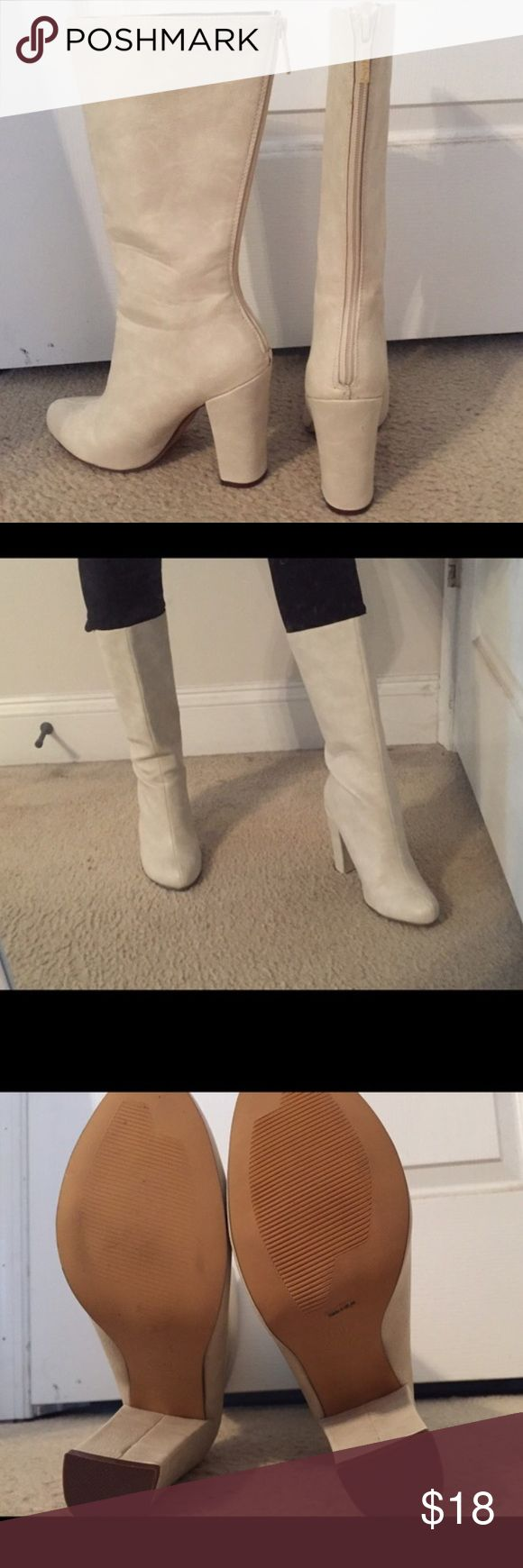 White high heeled boots Never worn high heeled boots! I bought these boots for my Halloween costume but didn't end up wearing them! The heel is about 4.5 inches. White/cream color. Michael Antonio Shoes Heeled Boots