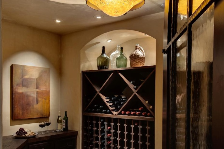 Fantastic wine rack in a California Mediterranean style home. Discovered on www.Porch.com.