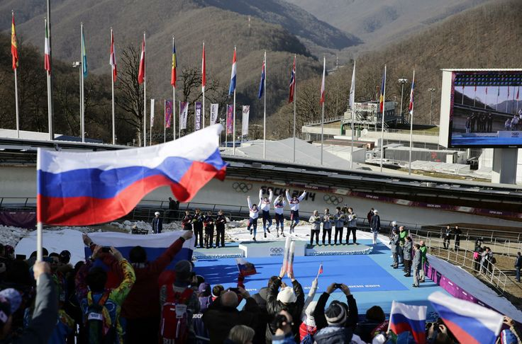 Photos of the day - February 23, 2014: The team from Russia RUS-1, with Alexander Zubkov, Alexey Negodaylo, Dmitry Trunenkov, and Alexey Voevoda, jump onto the medal stand after they won the gold medal during the men's four-man bobsled competition final at the 2014 Winter Olympics, Sunday, Feb. 23, 2014, in Krasnaya Polyana, Russia. (AP Photo/Jae C. Hong). Latvia and the United States took silver and bronze, respectively.