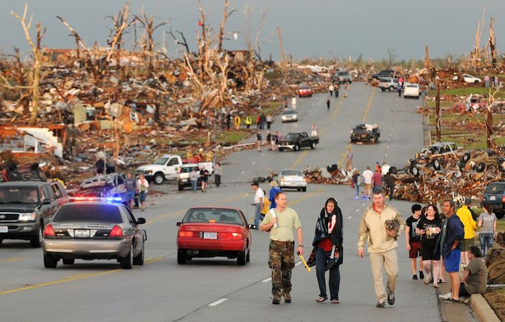 Residents of Joplin, Mo, walk west on 26th Street near Maiden Lane. (AP Photo/Mike Gullett) Joplin Tornado May 22, 2011
