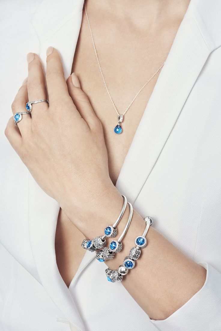 Match PANDORA's radiant blue pieces with an all-white outfit for a lavish expression. The shimmering stones will make you stand out even more. #PANDORAnecklace #PANDORAring #PANDORAbracelet
