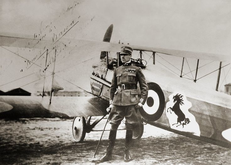 Count Francesco Baracca, standing by his SPAD S.XIII fighter (1918). The prancing horse logo, a tribute to his former cavalry regiment, later became the emblem of Ferrari.