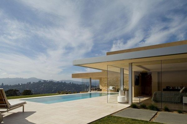 Floor to ceiling glass windows give this #midcentury #modern home a picturesque 360˚ vista