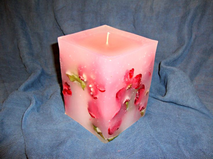 White handmade candle with pink, and red flowers- smells like peach