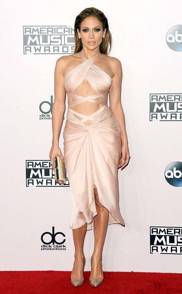 Jennifer Lopez from 2014 AMAs Red Carpet Arrivals  Hot damn! The songstress shows off her killer abs in this skin-baring Reem Acra number that she pairs with sparkling Christian Louboutin pumps.