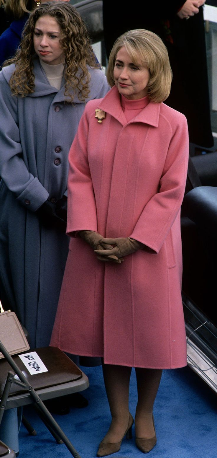 HILLARY CLINTON, in a salmon coat and matching turtleneck at inaugural parade, on Jan. 20 1997 on Capitol Hill in Washington, D.C.