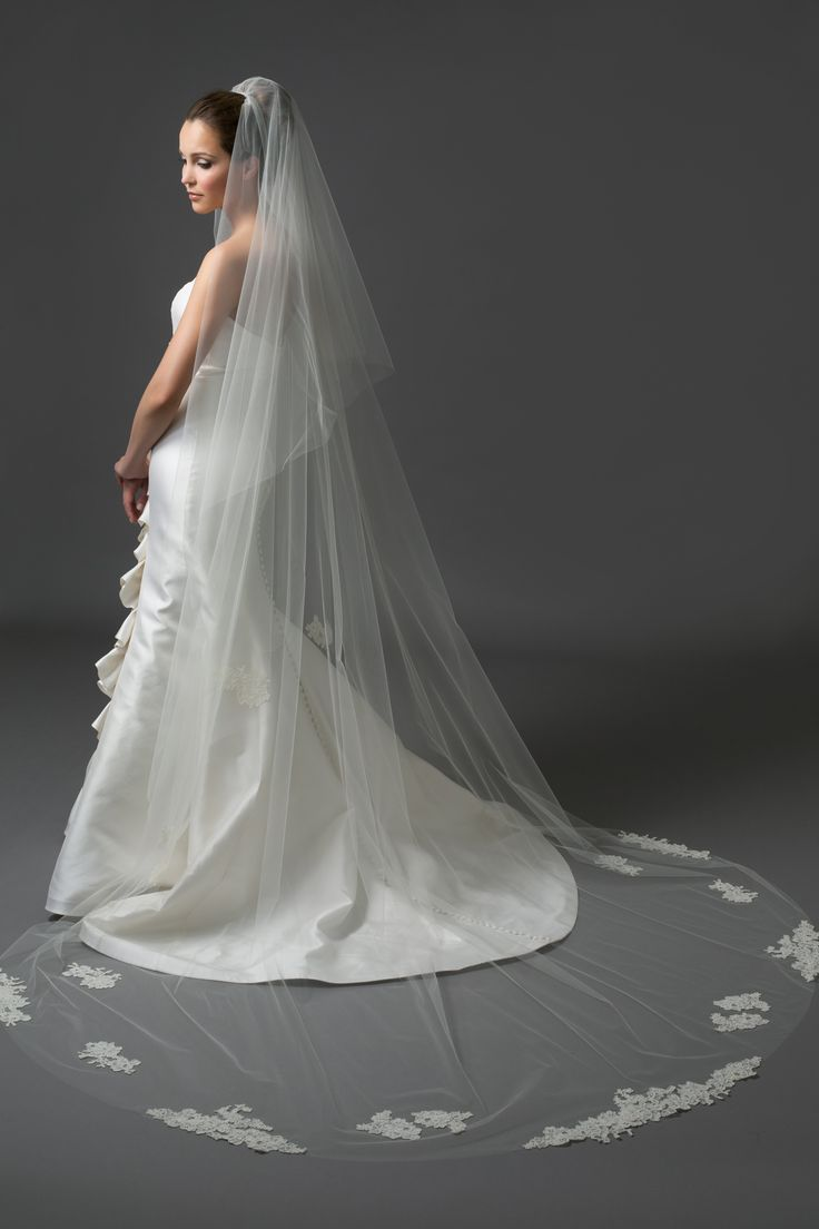 Chapel length veil with Alencon lace appliques.