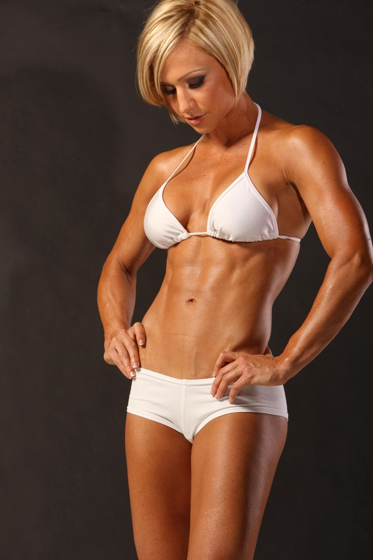Jamie Eason in her white bathing suit. Those abs are fit for a bodybuilding queen.