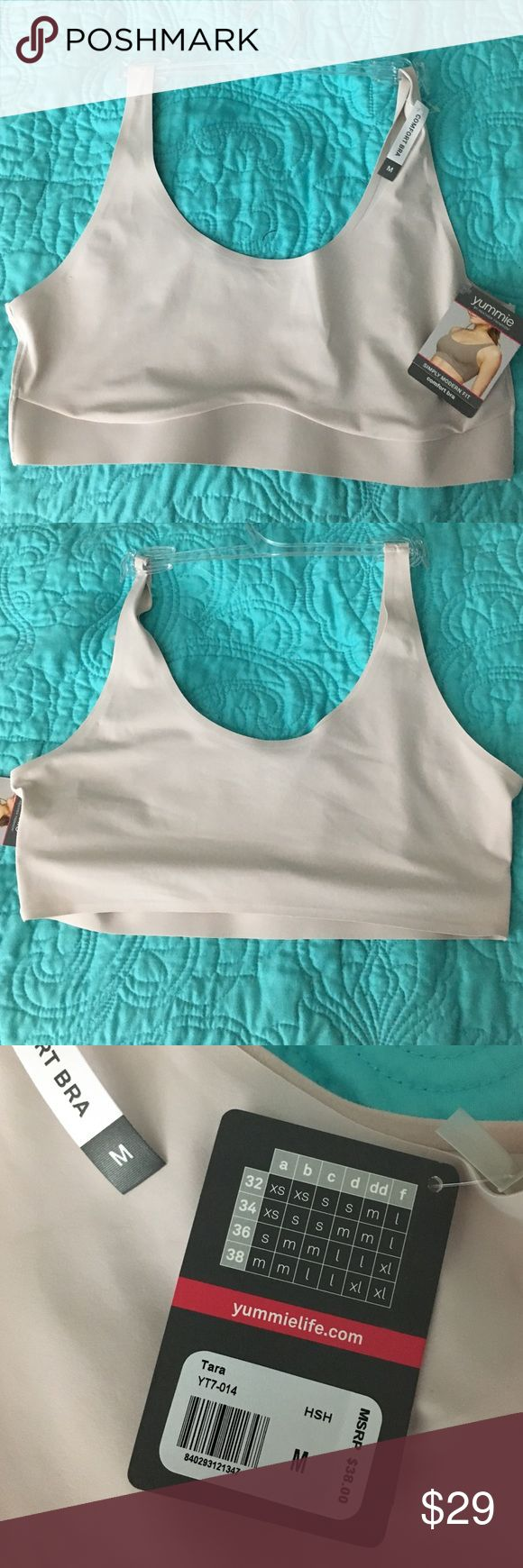 NWT Yummie Comfort Bra M REDUCED!! 💥 NWT Yummie Comfort Bra M. Simply modern fit. Disappearing edge means no show under clothing, wide side and back panels for no lumps and bumps, closure FREE for a clean look, pull over your head or step in and shimmy up. Light pinky beige, retail $38 Yummie by Heather Thomson Intimates & Sleepwear Bras