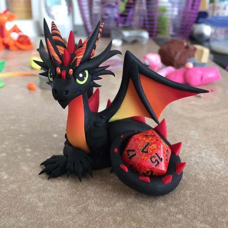 Here's the firey guy finished. I'm still working on a bunch of others but they're in various stages of completion. Should have enough for a sale this weekend though :) #claydragon #diceholder #d20 #dicedragon #fire #dragonsandbeasties #dungeonsanddragons