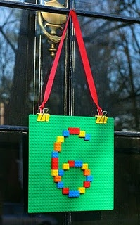 Lego party - Door Decoration - green lego base + legos, binder clips and ribbon