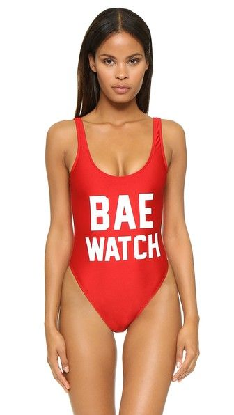 An iconic one-piece Private Party swimsuit gives a sly nod to pop culture with 'Bae Watch' lettering. Deep scoop neckline and high-cut leg openings. Lined.  Private Party Bae Watch One Piece Bathing Suit