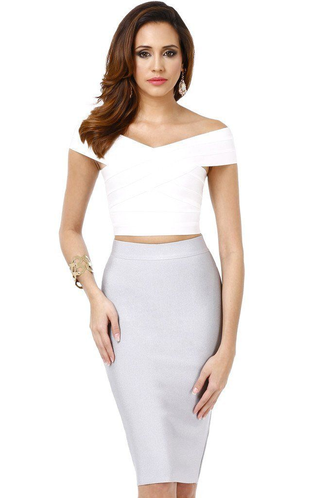 5f6ef17131 A stunning two-piece dress with an off-shoulder criss-cross bandage crop  top and a pencil bandage skirt. It's the perfect grey skirt, white top  combination.
