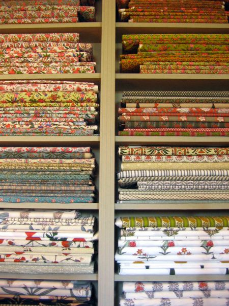 French Provencal fabrics in traditional colors and designs. Patterns used to be hand-blocked, with natural pigments of the region in shades of red, blue, yellow and green. Photo taken at Michel Biehn shop in L'Isle-sur-la-Sorgue (a town on the Sorgue river, southeastern France, region of Provence-Alpes-Côte d'Azur).