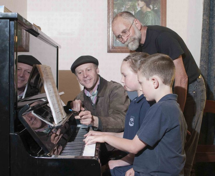 After many years working as a musical director, a rock 'n roll pianist and a cocktail lounge pianist you can now find musician Tim Edhouse teaching at Aldgate in the Adelaide Hills. Photo: Piano teacher Tim Edhouse with students Isabella and Riley Henderson. The Hendersons' grandpa John Fisk looks on. Photo by Philip Martin http://adelaidehills.realviewtechnologies.com/
