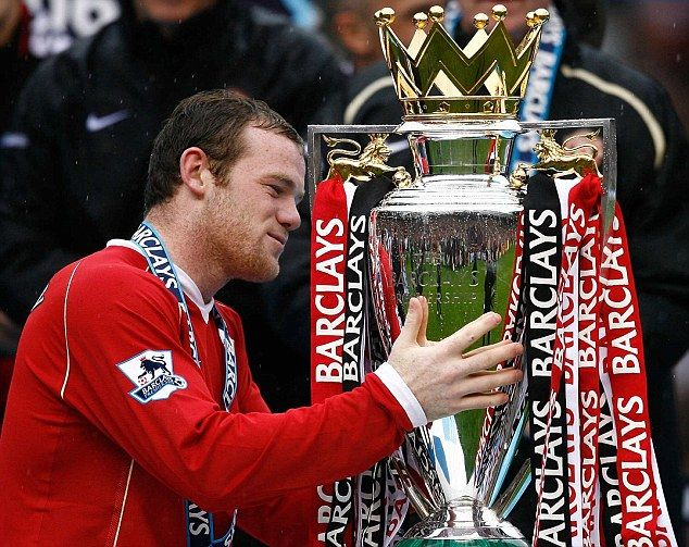 Manchester United forward Wayne Rooney caresses the Premier League trophy after claiming it in 2007