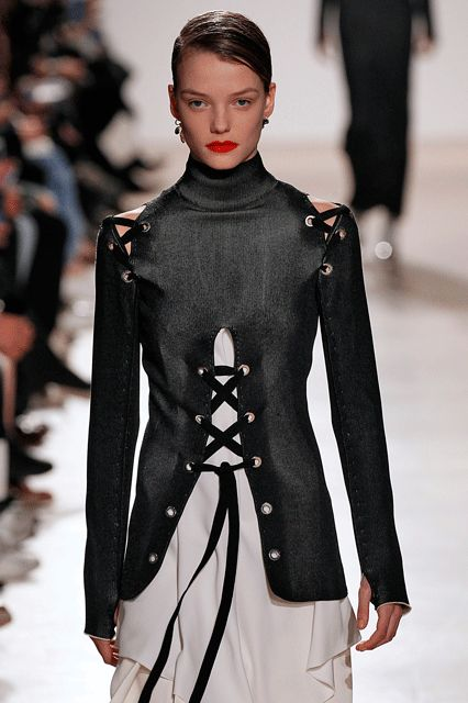 The Non-Basic Way To Wear The Lace-Up Trend That's Been Everywhere #refinery29  http://www.refinery29.com/2016/02/103551/proenza-schouler-fall-winter-nyfw-2016#slide-5  A sleeker, more creative way to keep your sleeves in tact....