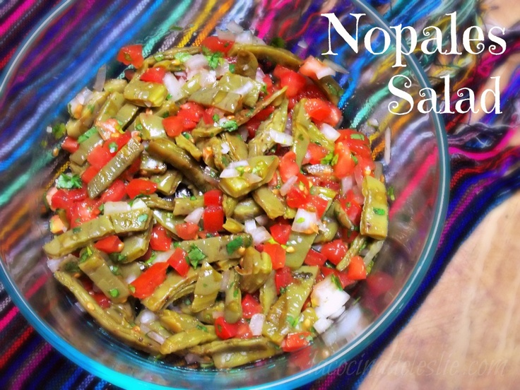Ensalada de Nopales  No, I don't want you to go and pick your own nopales.  You can buy a jar of these already cooked and sliced in the Mexican food isle of your grocery store.  Make sure that you rinse them well, before adding the rest of the ingredients.  :)
