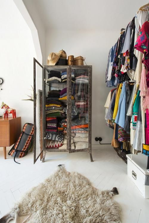 When you've amassed a collection of clothing this colorful, it would be a shame to hide it all away.