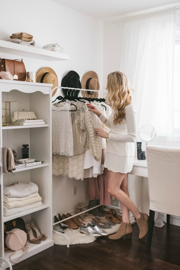 Pretty clothing & hat storage in a small space