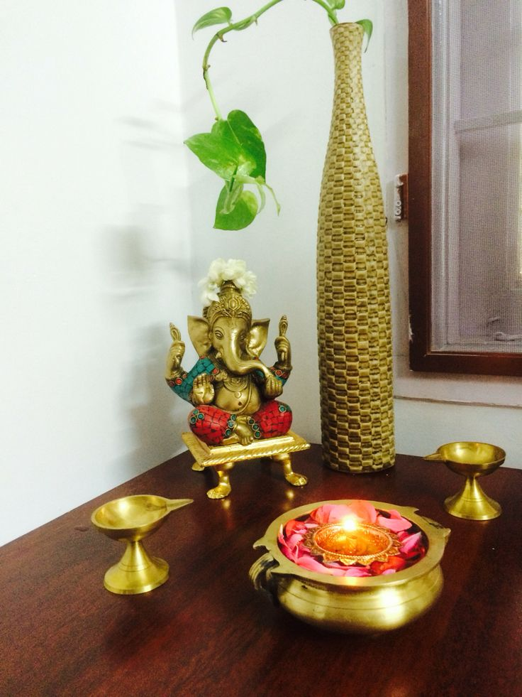 Brass Ganesha in a traditional setup