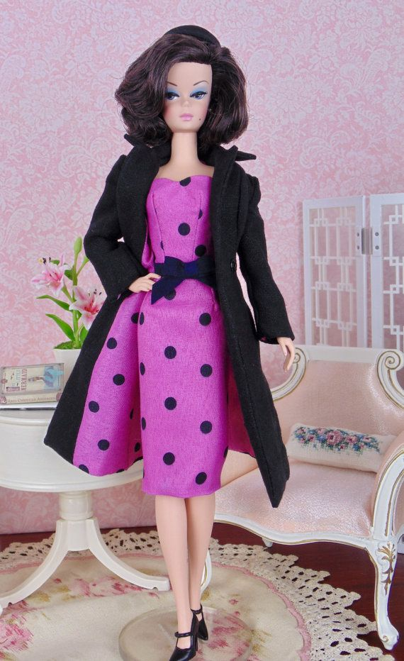 Dress, bolero jacket, double-breasted coat dress, pillbox hat, and picture hat. These separates were sewn entirely by hand from your scarf, cotton lining fabric, and black linen. An ultrasuede belt with attached bow accents the strapless dress. An attached rhinestone brooch adorns the lapel of the bolero jacket.  A mulberry paper rose decorates the crocheted picture hat.   This fashion is specially made to fit: - Silkstone Barbie - Victoire Roux - and similar size dolls   Fashion does not…