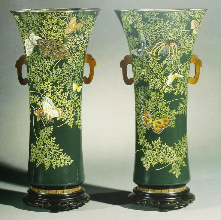 Pair of cloisonné vases worked in moriage enamels and silver wires. Silver rims and foot rims with silvered bronze liners. Made by Kawade Shibataro for the Ando Workshop. Height 32.5cm.