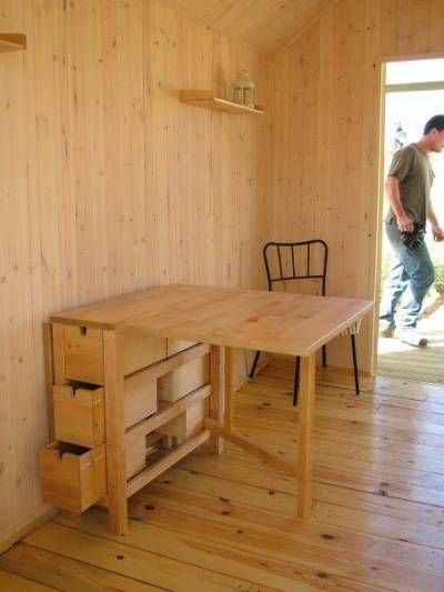 I'd like a little table like this one that saves space by folding up. I like that I could store table necessities in the drawer space. I think I might put it up on casters, so it could be moved around easily. I'd get some stacking or folding chairs to go with it.
