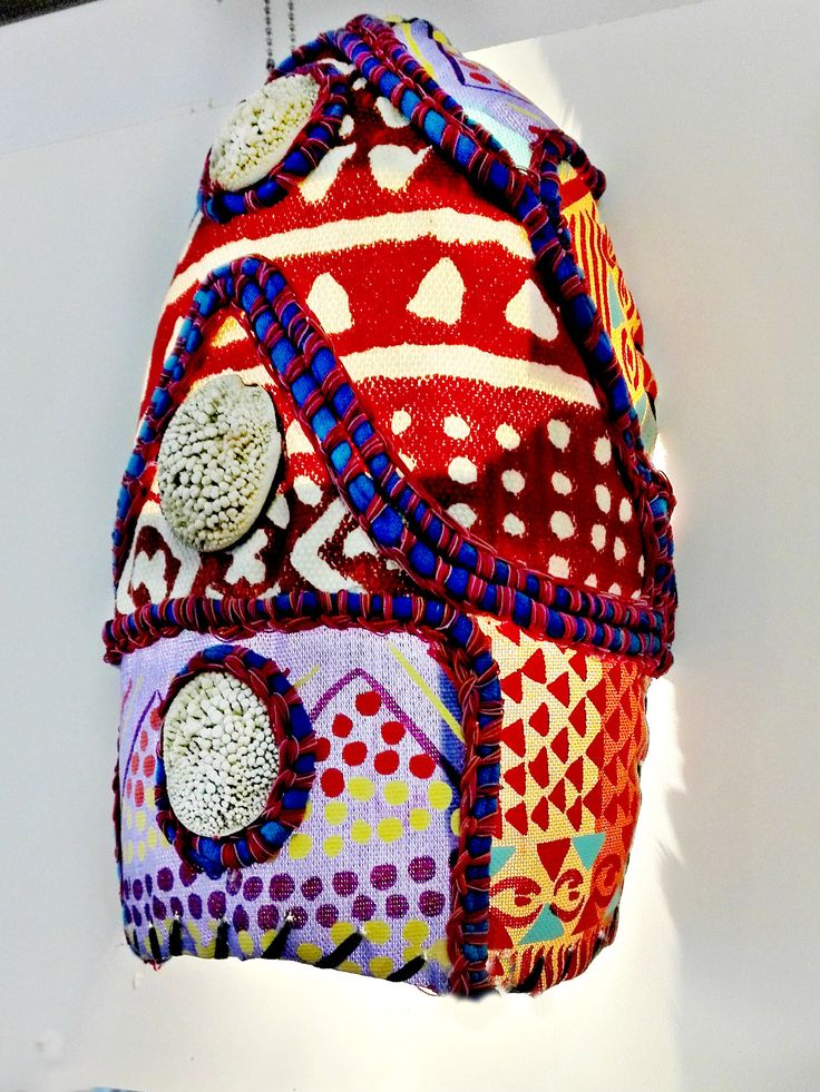 african textile patchwork onto 5liter plastic bottle- makes a great wall lampshade