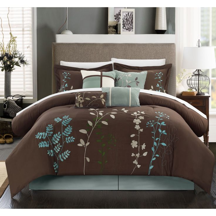 the bliss garden decorative comforter set features exquisitely embroidered floral vines set against a brown background this brown comforter set is