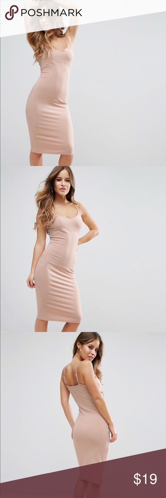 Nude bodycon dress .  Very cute. Simplistic and great to combine with chunky cardigans, kimonos, jackets, blazers. I ordered petite since I am 5'2. This  would fit anyone who wears an XS. It's form fitting but also stretchy. Adjustable straps. Length is below the knee. Just like on the model. Great color for spring.  ASOS Dresses Midi