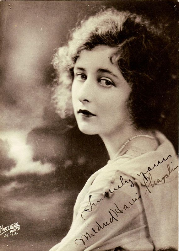 """Mildred Harris, c. 1918–1920 Publicity photo taken by Hartsook Photo, a now defunct chain of studios spread throughout California. Published and distributed. On 23 October 1918, Chaplin, age 29, married the popular child actress, Harris, who was 16 at the time. They had one son, Norman Spencer """"The Little Mouse"""" Chaplin, born on 7 July 1919, who died three days later and is interred under the name The Little Mouse at Inglewood Park Cemetery, Inglewood California."""