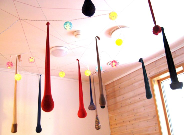 Inspired by artist Ernesto Neto, this Kinder class filled stockings with spices, peas, beans, and macaroni, and hung them from the ceiling. Fills room with good smells, and looks really cool!
