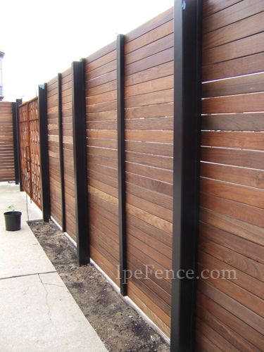 This Ipe fence is supported by steel beams to create a solid structure with a modern look.