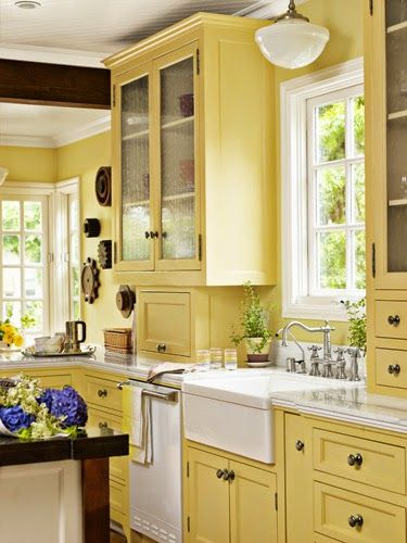 In the kitchen, the walls are painted Golden Straw and the cabinets are painted Sherwood Green, both by Benjamin Moore. The window frames are painted ...