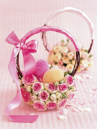 Make an elegant basket out of tightly packed rose blossoms, dried grapevines, and ribbons.
