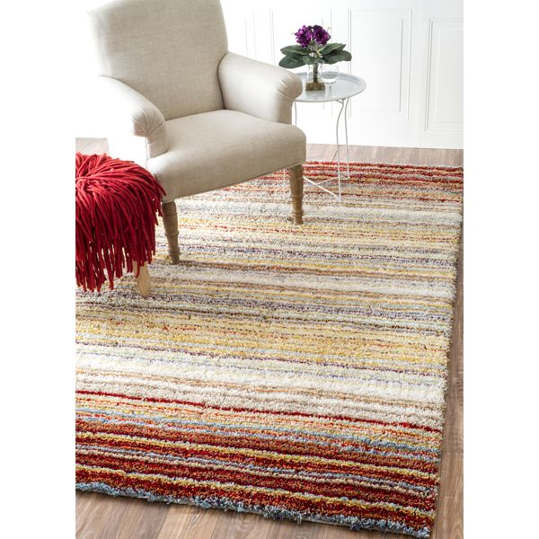 Add that finishing touch and warm up a room with the Classie Shag Indoor Rug-Red Multi.