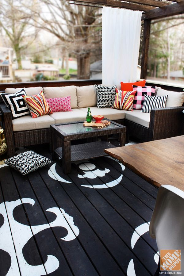 Outdoor Decorating with Color: A beautiful covered patio with an outdoor sectional, coffee table and painted floor