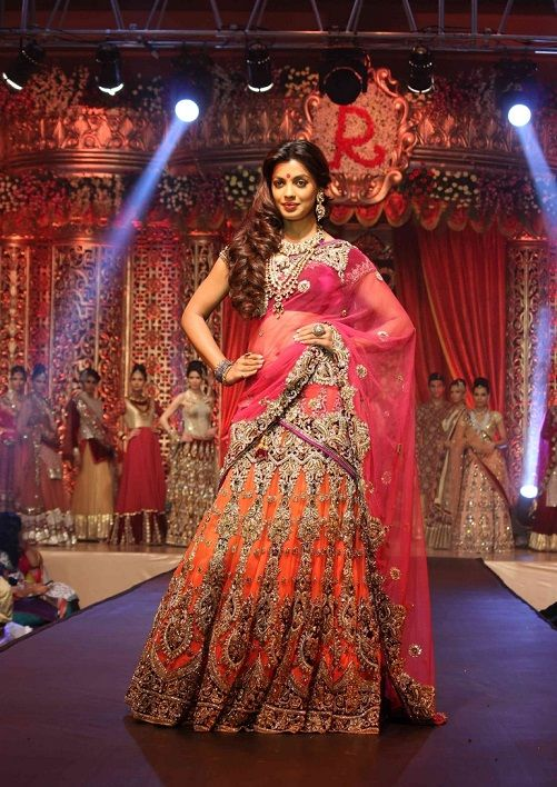 Vikram Phadnis the noted fashion designer presented the spectacular bridal collection at the Bridal Couture Show! Mugdha Godse, the showstopper, clad in a orange lehenga heavily embellished with gold, looking absolutely stunning!  You can find your designer Bridal Trousseau on http://www.myweddingbazaar.com/bridal-lounge.php  To view Vikram Phadnis Store detail visit http://www.myweddingbazaar.com/about_companys.php?id=312&&tpages=4&page=2&vendor_type=Designer+Collection