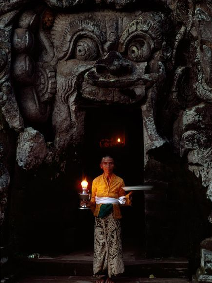 The intricately carved walls of Goa Gajah (Elephant Cave) on the island of Bali depict leaves, waves, animals, and demons.